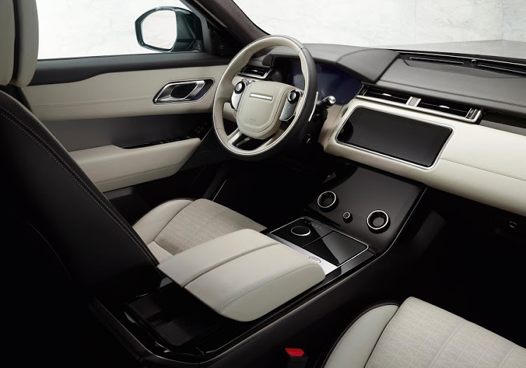 The interior is more minimalist than other Range Rover models