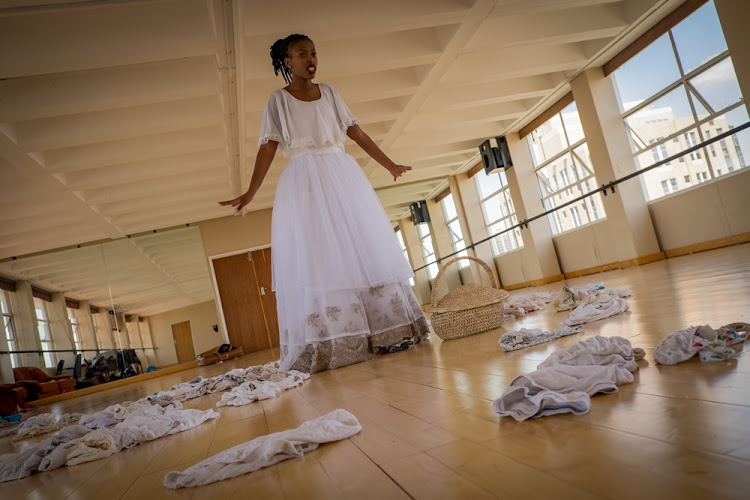 Artist Nondumiso Msimanga models her 'wedding' dress made out of worn underwear on November 4, 2016