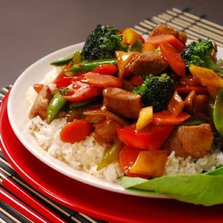 Steaming White Rice and Pork Stir Fry