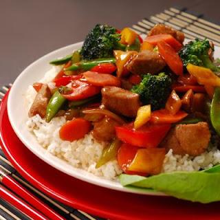 Steaming White Rice and Pork Stir Fry.