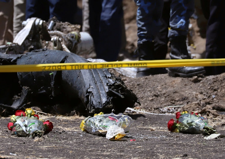 Flowers lie at the scene of the Ethiopian Airlines plane crash, southeast of Addis Ababa, Ethiopia, March 11 2019. Picture: REUTERS/TIKSA NEGERI