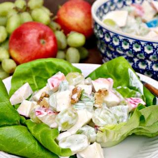 Classic Waldorf Salad with Fresh Crunchy Apples Over Bib Lettuce.
