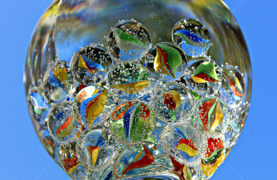 by Dipali S - Artistic Objects Other Objects ( water, sparkling, sky, blue background, glass, marbles )