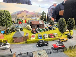 Photo: 014 A wider view of the classic car display at Stan Agar's Dragons Lair. A good idea for how to display a collection of Oxford, Pocketbond and Basetoys diecast vehicles. The Peco backscene complements this layout very well .