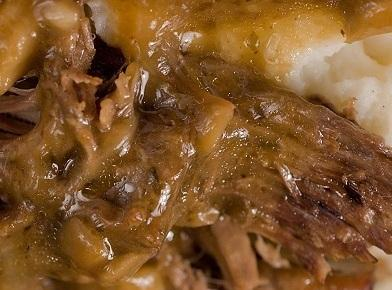 Place the roast in a 5-quart slow cooker and add the onion, bay leaves,...
