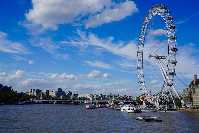 The London Eye, 443 feet tall, on the banks of the River Thames in London.