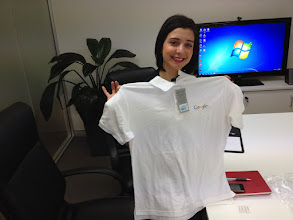Photo: Nat Geddes becomes an honourary Geek Shirt Friday member during a boardroom meeting today!