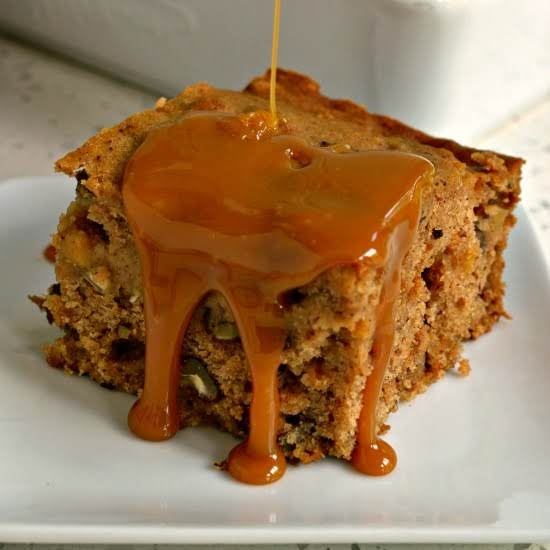 An Easy Family Friendly Scrumptiously Moist Applesauce Spice Cake With Pecans And Raisins. It Is Perfect For Potlucks, Family Events, Fall Parties And Festivals.