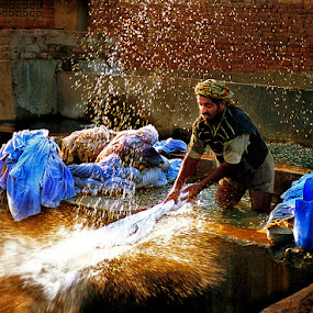 Washinglines 2 by Sami Ur Rahman - People Street & Candids ( water drops, washing linen, factory worker, old methods, splashing clothes, hard labour )