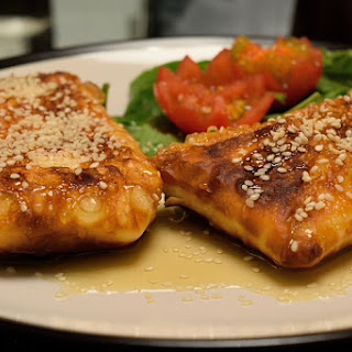 Fried Feta Envelopes with Honey and Sesame Seeds.