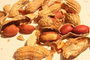 How can I safely give peanuts to my cat