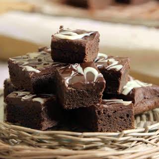 Brownies with Ganache and White Chocolate Swirls.