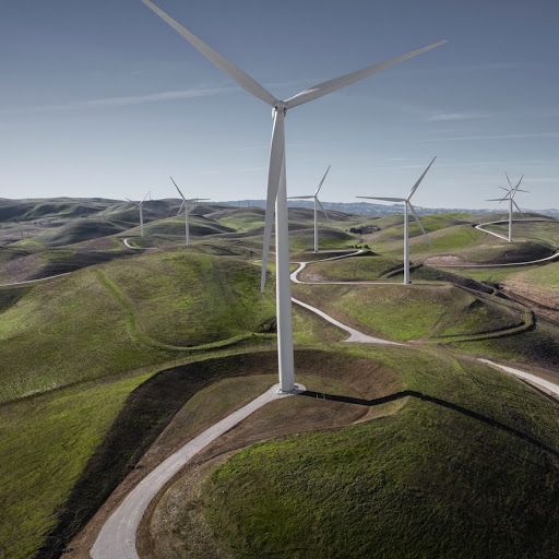 Elevated view of wind turbines in green rolling hills
