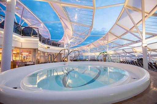 harmony-of-seas-hot-tub-pool-at-solarium.jpg - The hot tub pool at the Solarium aboard Royal Caribbean's new ship Harmony of the Seas.