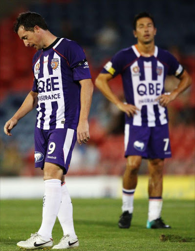 Robbie Fowler and Jacob Burns of the Glory look dejected after going down to the Jets during the round 26 A-League match between the Newcastle Jets and the Perth Glory at EnergyAustralia Stadium on February 10, 2011 in Newcastle, Australia