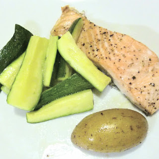 Baked Salmon with Zucchini and Potatoes.