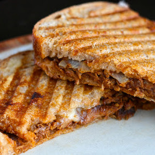 Slow Cooker Pulled Pork Paninis with Caramelized Onions and Homemade BBQ Sauce.