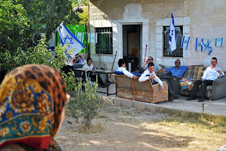 Photo: A Palestinian woman is mocked by Israeli settlers in front of what used to be her home in Shiekh Jarrah, East Jerusalem. ($100)