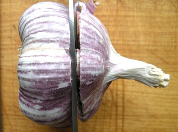 Preheat oven to 350 degrees F.  Take the head off of garlic. Cut...