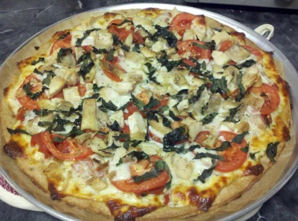 Place pizza on center rack of oven and lower heat to 425° F. Bake...