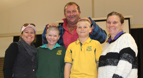 Wee Waa Public School students Toby Galagher and Brody Slee proudly show off their brand-new hairstyles on Friday after taking part in the World's Greatest Shave for leukemia research, a cause for which they raised about $2000. With them are Toby's mum Rhonda Galagher and Brody's parents Brendon and Raylene Slee.