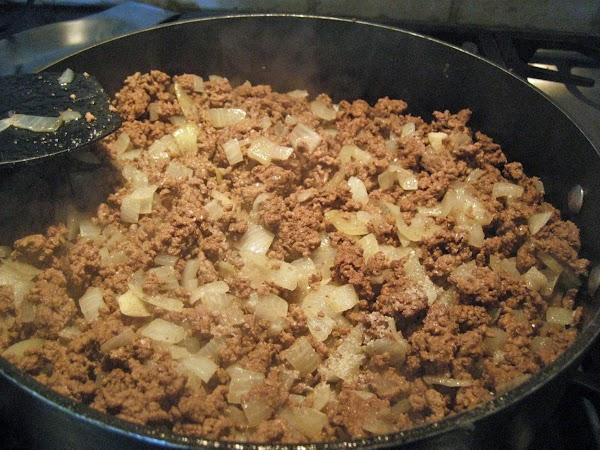 In a skillet brown your onions and ground meat with a dash of salt...