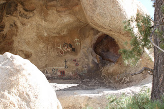 Photo: Petroglyphs. Those in color have been vandalized. Originally, they're white.