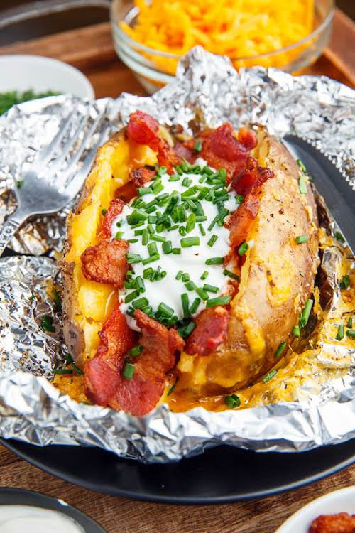 "Slow Cooker Loaded Baked Potatoes ""Quick and super easy slow cooker baked..."