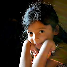 Sun Rays on Child by Umair Nayab - Babies & Children Child Portraits ( girl child, thinking, green, portrait, sun rays,  )