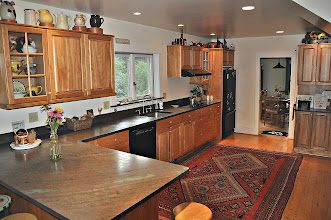 Photo: Kitchen with red birch cabinets + full compliment of cookware