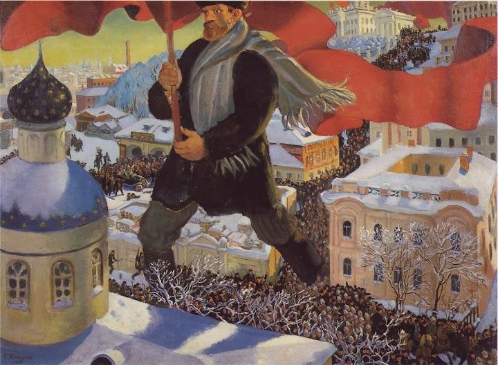 Menschen marschieren durch Straßen, überhöhte Figur mit roter Fahne im Vordergrund.