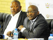 Education MEC Mandla Makupula (right) with the former head of the department,  Modidima   Mannya