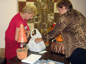 Photo: Member makes a purchase at the Ways and Means Table