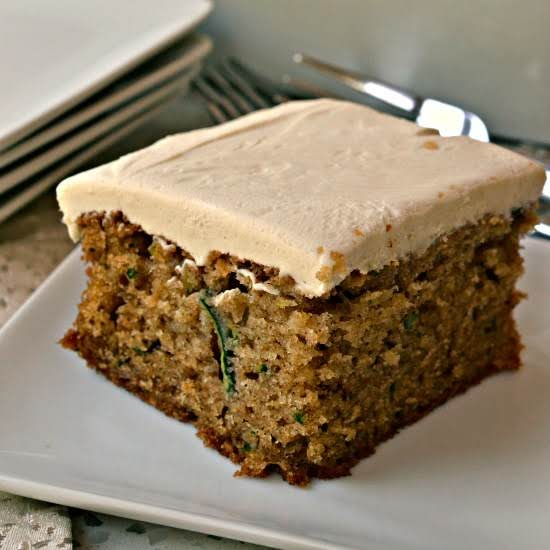 This Scrumptious And Moist Zucchini Cake Is Flavored With Fresh Zucchini, Walnuts, Cinnamon, Nutmeg And Allspice. It Is All Topped With An Easy Four Ingredient Brown Sugar Cream Cheese Frosting.