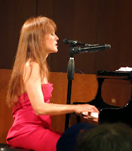 Photo: Hannah sings one of her original compositions.
