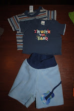 Photo: Size SMALL Fleece Shorties with EXTRA layer of fleece inside. 0-3 months Old Navy and Circo T-shirts. These Shorties are made by me and are the Little Comet Tails Pattern. I use the Home Sew License and am not selling these for a profit,  I made them for my sons. $16ppd for all you see here. Close up of the guitar applique also in this album.