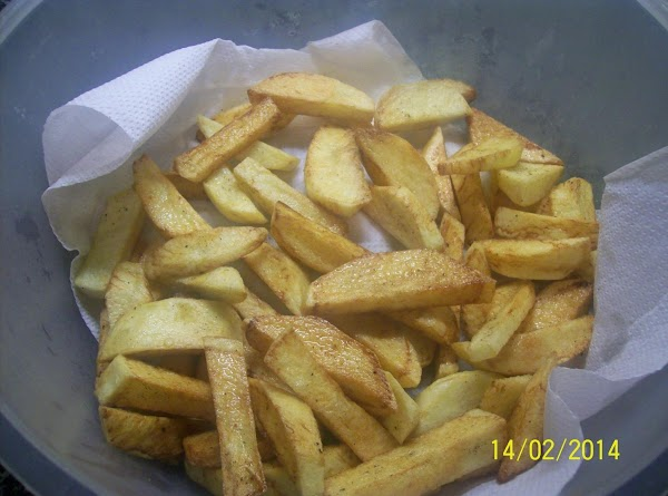 Cook the home made chips , in a deep fat fryer for about 8...
