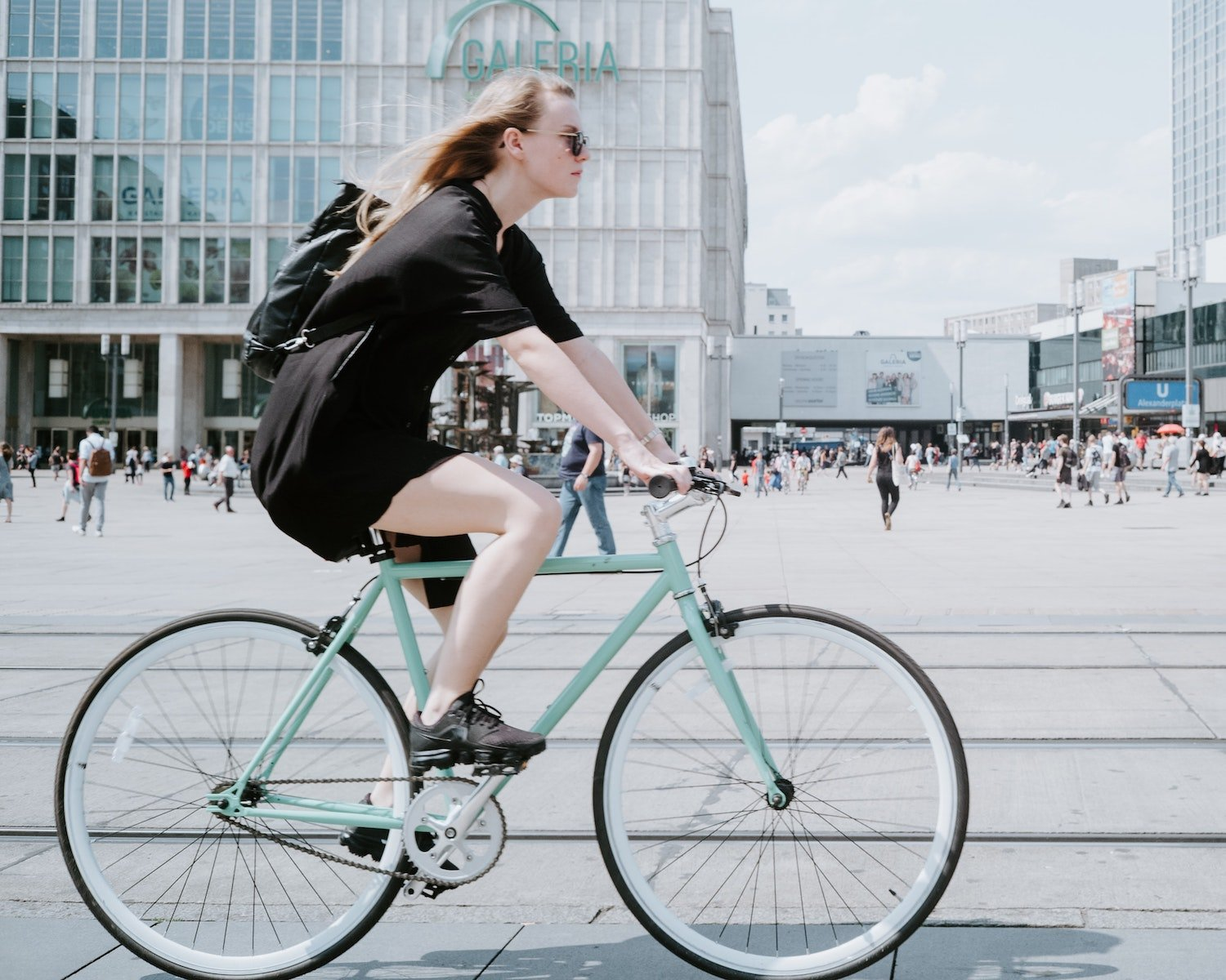 woman riding bike in the city