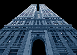 Photo: I took this shot 3 years ago when I was visiting New York on business. The building is the Equitable Building and this shot shows the entrance on Nassau Street. The Equitable Building has an interesting history. In particular, it was this building that started some of the first zoning laws in New York City regarding building heights and setback requirements. It was feared (probably rightly so) that tall buildings without adequate setbacks would make New York a city of dark canyons.  I posted this shot to Flickr and someone noticed it and wondered if they could use it for a book they were putting together on open source software architecture. They told me that they couldn't pay me for the image, but the proceeds from the book were going to be donated to Amnesty International. I told them they could go ahead and use the image. Recently the book was published and the image looks pretty good on the cover. Check it out here:  http://www.aosabook.org/en/index.html  Even though I didn't make any money off of the image, it's pretty cool having it on the cover of a book.