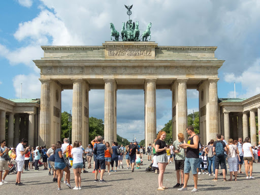 The always-crowded Brandenburg Gate is a neoclassical monument in Berlin built in the 1700s.