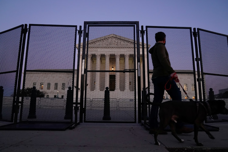 The US supreme court behind security fencing in Washington, the US, January 12 2021. Picture: REUTERS/ERIN SCOTT