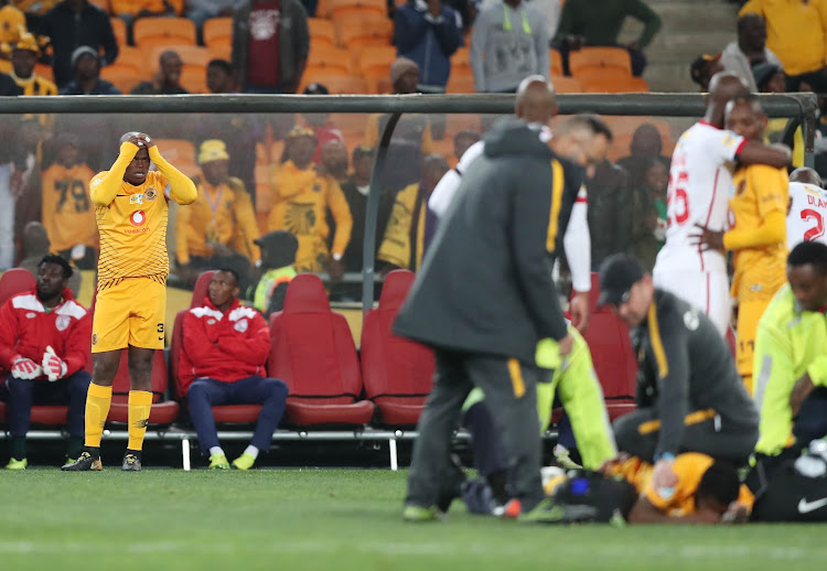 Kaizer Chiefs midfielder Willard Katsande reacts in anguish after witnessing a horrific injury to his teammate Joseph Molangoane (lying on floor) during the MTN8 quarterfinal 3-0 win over Free State Stars at FNB Stadium in August 2018.