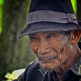 Smiling  farmer by Chusnul Hidayat - People Portraits of Men