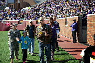 Photo: The Minnesota Vikings recognized Army Staff Sgt. Cassie Mecuk during the Vikings game at University of Minnesota Stadium on Oct. 12, 2014. Mecuk, who survived recurring bouts with breast cancer, was recognized as part of Breast Cancer Awareness Month.