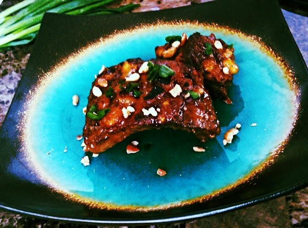 Top ribs with chopped scallions and chopped nuts.  Enjoy!