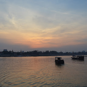 Going Home by Azzah Rahman - Landscapes Sunsets & Sunrises ( mekong river, phnom penh, sunset, boat, cambodia, river )