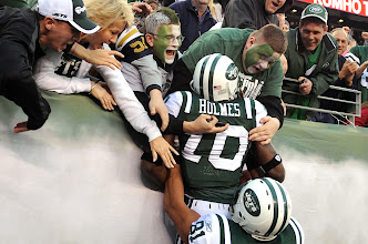 Photo: New York Jets wide receiver Santonio Holmes is hoisted to fans by New York Jets tight end Dustin Keller after scoring the game-winning TD in the fourth quarter. Photo by Robert Deutsch, USA TODAY.