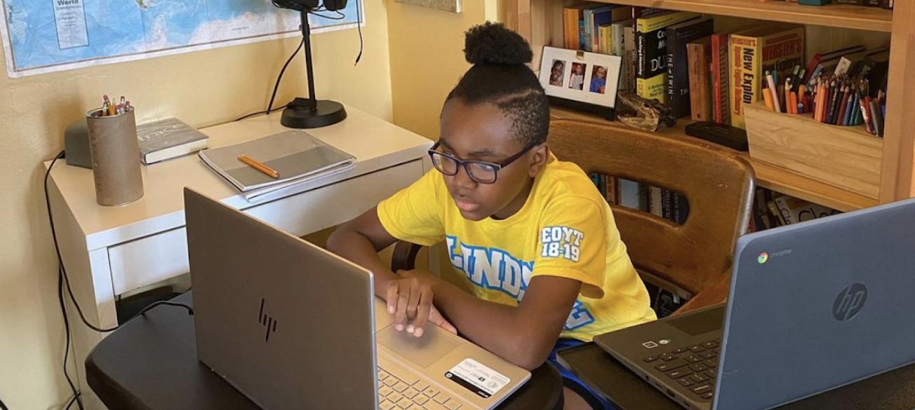 Child studying using laptop