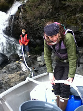 Photo: Me and their new wwoofer, Sara helping Rick get water from the falls