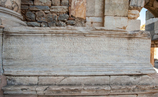 Inscription-at-Library-of-Celsus-1.jpg - The Library of Celsus was completed in 135 AD as a mausoleum for Celsus, a Roman senator who was buried in a sarcophagus beneath the library's entrance.